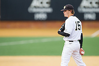 Wake Forest Demon Deacons starting pitcher Jack Fischer (15) looks to his catcher for the sign against the Maryland Terrapins at Wake Forest Baseball Park on April 4, 2014 in Winston-Salem, North Carolina.  The Demon Deacons defeated the Terrapins 6-4.  (Brian Westerholt/Four Seam Images)