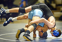 Quakertown's Josh Stahl (top) attempts to roll North Penn's Jee Ea Gay during the 106 lb match at Quakertown High School Wednesday January 6, 2016 in Quakertown, Pennsylvania. (Photo by William Thomas Cain)