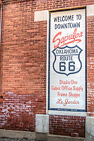 Murals on buildings in Downtown Supulpa Oklahoma on Route 66, have been repainted as they originally looked.