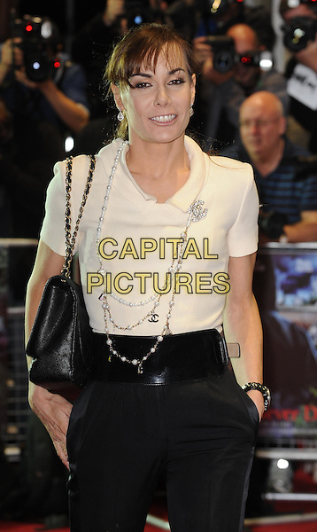 Tara Palmer Tomkinson.UK film premiere of 'Demons Never Die' held at the Odeon West End - Arrivals, London, England..October 10th, 2011.half length white top black trousers belt hands in pockets tpt bag purse necklaces .CAP/WIZ.© Wizard/Capital Pictures.