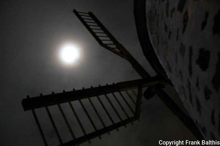 windmill and moon on winter night