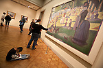"""Patrons enjoy George Seurat's """"A Sunday on La Grande Jatte"""" at the Art Institute of Chicago, Chicago, IL"""