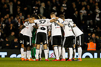 Fulham FC huddle before kick off during the Sky Bet Championship match between Fulham and Sheff United at Craven Cottage, London, England on 6 March 2018. Photo by Carlton Myrie.