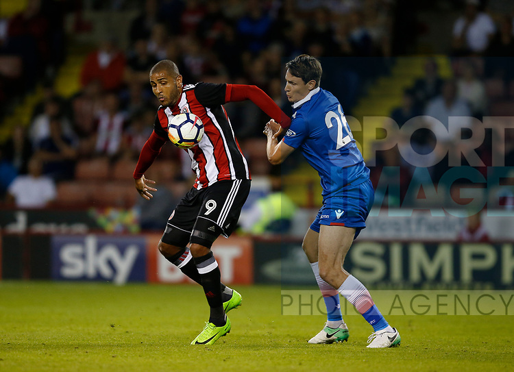 Leon Clarke of Sheffield Utd tussles with Philipp Wollscheid of Stoke City during the pre season friendly at Bramall Lane Stadium, Sheffield. Picture date: July 25th 2017. Picture credit should read: Simon Bellis/Sportimage