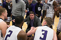 Fayetteville head coach Brad Stamps talks to his players during a basketball game, Friday, January 10, 2020 at Fayetteville High School in Fayetteville. Check out nwaonline.com/200111Daily/ for today's photo gallery.<br /> (NWA Democrat-Gazette/Charlie Kaijo)