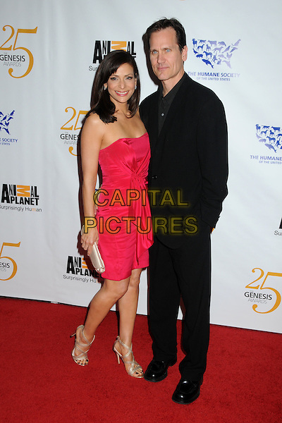 CONSTANCE MARIE & GUEST .25th Anniversary Genesis Awards held at the Hyatt Regency Century Plaza, Century City, California, USA, .19th March 2011..full length strapless pink dress  black suit couple .CAP/ADM/BP.©Byron Purvis/AdMedia/Capital Pictures.