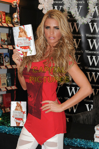 "Katie Price - Jordan.Signs copies of her new book ""Santa Baby"" at Waterstones, Bluewater, Greenhithe, Kent, England..November 4th, 2011 .half length pink red top hand on hip.CAP/BRC.©Ben Rector/Capital Pictures."