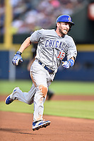 Chicago Cubs left fielder Chris Denorfia (15) runs to third during a game against the Atlanta Braves on July 18, 2015 in Atlanta, Georgia. The Cubs defeated the Braves 4-0. (Tony Farlow/Four Seam Images)