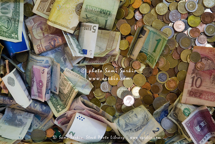 Pile of international coins and banknotes.