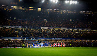 The teams head onto the pitch during the Carabao Cup semi final 1st leg match between Chelsea and Arsenal at Stamford Bridge, London, England on 10 January 2018. Photo by Andy Rowland.