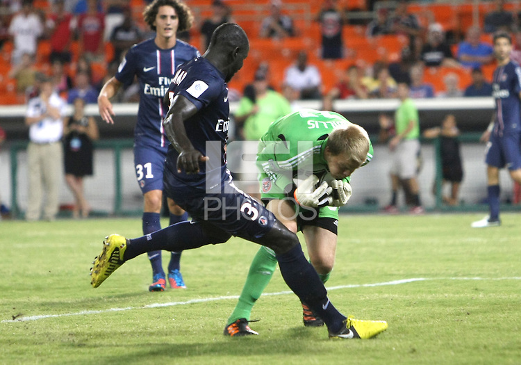 WASHINGTON, DC - July 28, 2012:  Joe Willis (31) of DC United grabs the ball from Mamadou Sakho (3) of PSG (Paris Saint-Germain) in an international friendly match at RFK Stadium in Washington DC on July 28. The game ended in a 1-1 tie.