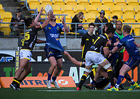 Matt Faddes loses the ball under pressure from Trent Renata during the Mitre 10 Cup rugby match between Wellington Lions and Otago at Westpac Stadium in Wellington, New Zealand on Sunday, 19 August 2018. Photo: Dave Lintott / lintottphoto.co.nz