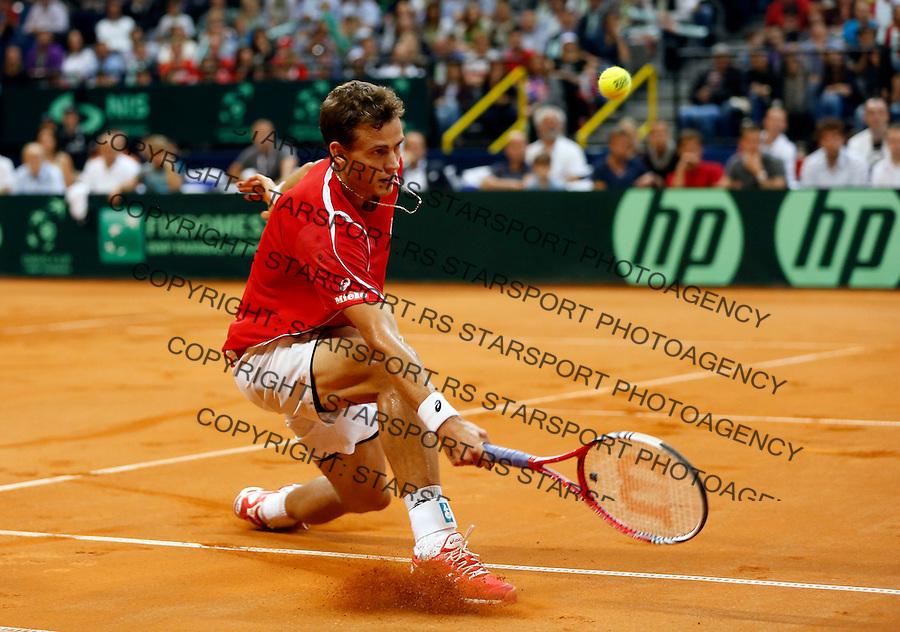 Tennis Tenis<br /> Davis Cup semifinal polufinale<br /> Serbia v Canada<br /> Novak Djokovic v Vasek Pospisil<br /> Vasek Pospisil returns the ball<br /> Beograd, 13.09.2013.<br /> foto: Srdjan Stevanovic/Starsportphoto &copy;