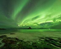 Northern lights shine in sky over Bleikøya, Bleik, Vesterålen, Norway