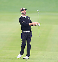 Matthew Baldwin (ENG) plays his 3rd shot on the 13th hole during Sunday's Final Round of the 2014 BMW Masters held at Lake Malaren, Shanghai, China. 2nd November 2014.<br /> Picture: Eoin Clarke www.golffile.ie