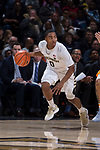 Brandon Childress (0) of the Wake Forest Demon Deacons pushes the ball up the court during first half action against the Tennessee Volunteers at the LJVM Coliseum on December 23, 2017 in Winston-Salem, North Carolina.  The Volunteers defeated the Demon Deacons 79-60.  (Brian Westerholt/Sports On Film)