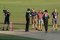 Umpires Rob Bailey and Mike Burns speak to the ground staff as the low sun causes play to be suspended during Kent Spitfires vs Essex Eagles, Vitality Blast T20 Cricket at the St Lawrence Ground on 2nd August 2018