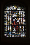 St Marys Church Kemsing Kent Uk. Stained glass window of St Edith. Kemsing was the birthplace in AD961 of Saint Edith of Wilton an illegitimate daughter of the Saxon King Edgar I. The well at the centre of the village is dedicated to her according to local legend her saintly presence has given the water healing properties. Annual pilgrimage to Well for unveiling of the Well Dressing plaque. September 2014.
