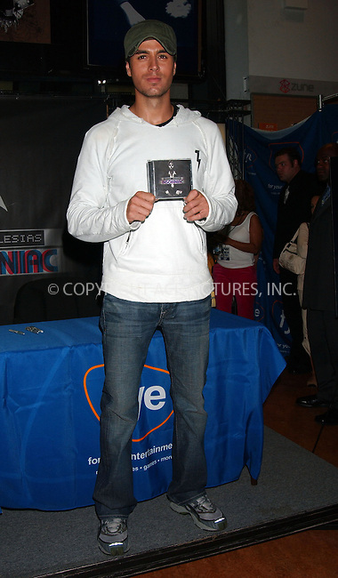 """WWW.ACEPIXS.COM . . . . . ....Recording artist Enrique Iglesias signed his latest CD """"Insomniac"""" at FYE Rockefeller Center.....Please byline: KRISTIN CALLAHAN - ACEPIXS.COM.. . . . . . ..Ace Pictures, Inc:  ..(646) 769 0430..e-mail: info@acepixs.com..web: http://www.acepixs.com"""