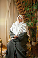 Salwa Abdel Wahab, 39 years old, is a human development trainer; she has two children. Salwa has been engaged in the Muslim Brotherhood organisation for twenty years. Here she poses in Amal Abdel El-Karim's apartment in Doqqi district - Amal is in charge of the women section of FJP in Giza. Cairo, Egypt. October 2012.