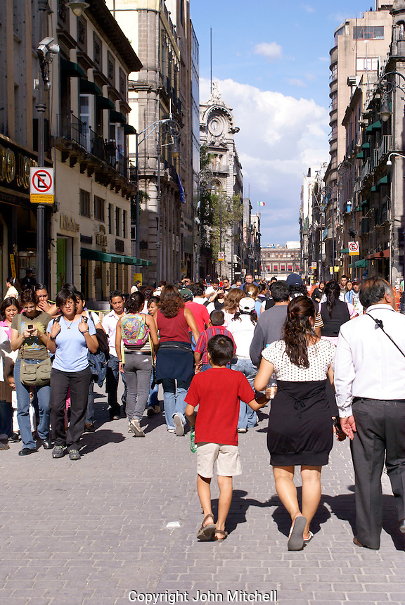 Crowds of pedestrians on Avenida Madero in downtown Mexico City