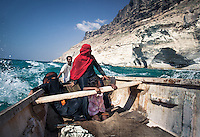 A fisherman from Matief, an isolated village on the south coast, carries his family all the way to visit relatives in Ras Irsel, at the easternmost point of the island. Along the uninhabited stretch of coast the beautifully carved cliffs drop off into the waters given home to a wide variety of sea birds, like cormorants and brown boobys.