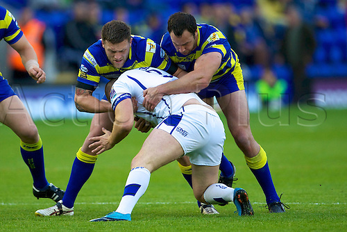 20.05.2011. Warrington Wolves v Swinton Lions. Simon Grix and Adrian Morley tackle Gavin Dodd. Warrington Wolves 112 Swinton Lions 0.