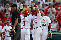 March 20, 2010:  Ruben Gotay (3) of the St. Louis Cardinals is congratulated by Matt Pagnozzi (19), Nick Stavinoha (34) and teammates after hitting a walk off home run during a Spring Training game at the Roger Dean Stadium Complex in Jupiter, FL.  Photo By Mike Janes/Four Seam Images