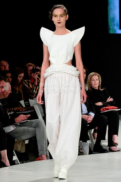 Model walks runway in an outfit by Raya Kassisieh, during the 2013 Pratt Institute Fashion Show, on April 25, 2013.