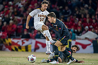 COLLEGE PARK, MD - NOVEMBER 21: Najim Romero #10 of Iona shoots between Eli Crognale #10 and Justin Harris #20 of Maryland during a game between Iona College and University of Maryland at Ludwig Field on November 21, 2019 in College Park, Maryland.