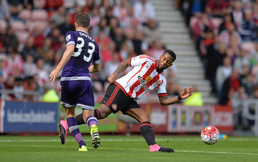 Tottenham Hotspur's Ben Davies and Sunderland's Jeremain Lens battle for the ball<br /> <br /> Photographer Dave Howarth/CameraSport<br /> <br /> Football - Barclays Premiership - Sunderland v Tottenham Hotspur - Sunday 13th September 2015 - Stadium of Light - Sunderland<br /> <br /> &copy; CameraSport - 43 Linden Ave. Countesthorpe. Leicester. England. LE8 5PG - Tel: +44 (0) 116 277 4147 - admin@camerasport.com - www.camerasport.com
