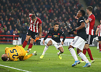 24th November 2019; Bramall Lane, Sheffield, Yorkshire, England; English Premier League Football, Sheffield United versus Manchester United; Mason Greenwood of Manchester United scores pqast Simon Moore of Sheffield United  in the 77th minute to make it 2-2 with Chris Basham and Phil Jagielka  of Sheffield United close by - Strictly Editorial Use Only. No use with unauthorized audio, video, data, fixture lists, club/league logos or 'live' services. Online in-match use limited to 120 images, no video emulation. No use in betting, games or single club/league/player publications