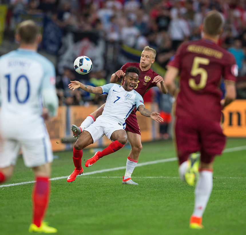 England's Raheem Sterling battles for possession with Russia's Igor Smolnikov<br /> <br /> Photographer Craig Mercer/CameraSport<br /> <br /> International Football - 2016 UEFA European Championship - Group B - England v Russia - Saturday 11th June 2016 - Stade Velodrome, Marseille - France <br /> <br /> World Copyright &copy; 2016 CameraSport. All rights reserved. 43 Linden Ave. Countesthorpe. Leicester. England. LE8 5PG - Tel: +44 (0) 116 277 4147 - admin@camerasport.com - www.camerasport.com