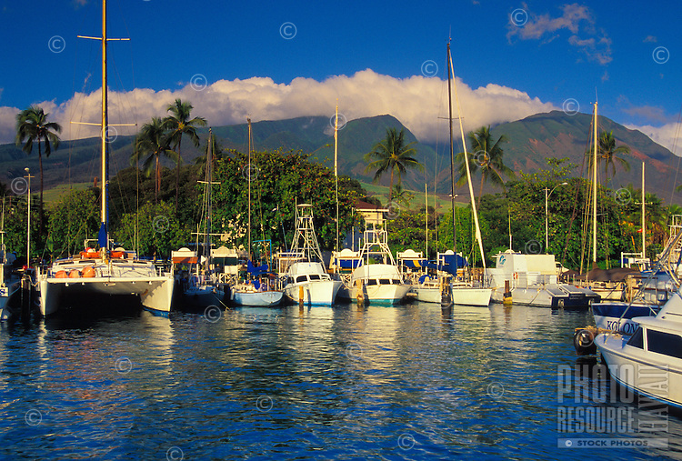 Lahaina Harbor and reflections right before sunset with the West Maui Mountains in the background. From 1820-circa.1860, Lahaina was the whaling capital of the world with over a hundred whaling ships anchored in the harbor at any given time.