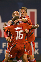 Toronto FC forward Chad Barrett (19) celebrates scoring his second goal with defender Marvell Wynne (16) and defender Hunter Freeman (2). Toronto FC defeated the New York Red Bulls 3-1 during a Major League Soccer match at Giants Stadium in East Rutherford, NJ, on October 04, 2008. Photo by Howard C. Smith/isiphotos.com