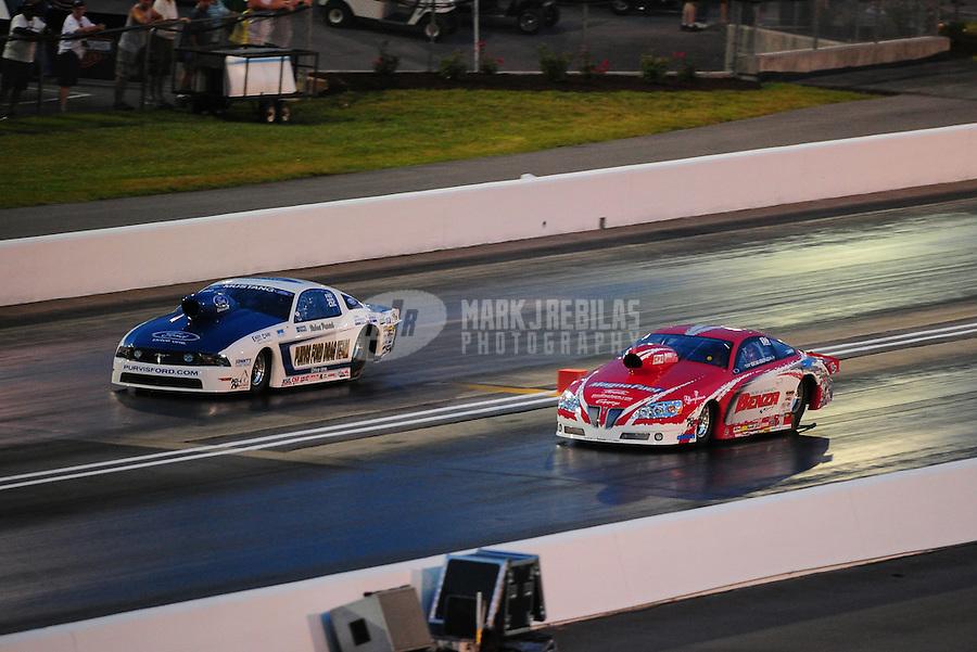 Jun. 17, 2011; Bristol, TN, USA: NHRA pro stock driver Robert Patrick (left) alongside Bob Benza during qualifying for the Thunder Valley Nationals at Bristol Dragway. Mandatory Credit: Mark J. Rebilas-
