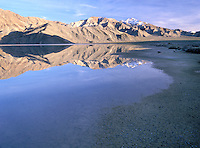 Water from recent rains sits in a usually dry lake bed.  Death Valley National Park