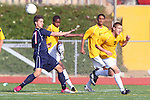 Torrance, CA 02/23/11 - West's Ike Akubuilo  (West #10) clears a ball in front of Tesoro's Derek Garcia (Tesoro #17) as his teammate Andrew Johnson  (West #7) ducks for cover.
