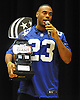 New York Giants running back Rashad Jennings speaks to audience members inside Roosevelt High School's auditorium before presenting senior Chukwuma Ukwu (not in picture) with the Heart of a Giant Award on Tuesday, Dec. 15, 2015. Ukwu, who played on Roosevelt's varsity football team, was honored for his dedication on the gridiron and exceptional service to his local community.