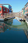 A wooden bridge over a canal in Burano, Italy on April 15, 2013.  .Credit: Ron Sachs / CNP