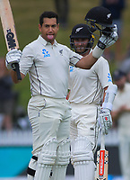 NZ's Ross Taylor celebrates his century with Kane Williamson during day five of the international cricket 2nd test match between NZ Black Caps and England at Seddon Park in Hamilton, New Zealand on Tuesday, 3 December 2019. Photo: Dave Lintott / lintottphoto.co.nz
