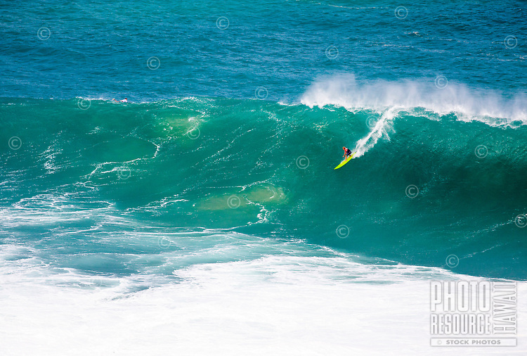 First Place winner John John Florence rides a wave at the 2016 Big Wave Eddie Aikau Contest, Waimea Bay, North Shore, O'ahu.