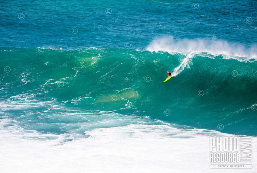 First Place winner John John Florence rides a wave at the 2016 Big Wave Eddie Aikau Contest, Waimea Bay, North Shore, O'ahu.
