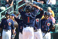 Carlos Correa #1 of the Lancaster JetHawks is greeted by his teammates after hitting his first home run of the season during a game against the Lake Elsinore Storm at The Hanger on April 6, 2014 in Lancaster, California. Lancaster defeated Lake Elsinore, 7-4. (Larry Goren/Four Seam Images)