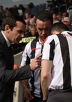 Danny Lennon (left) gives instructions to substitutes Dougie Imrie and Steven Thomson in the St Mirren v Hibernian Clydesdale Bank Scottish Premier League match played at St Mirren Park, Paisley on 29.4.12.