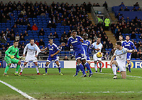 Kenneth Zohore of Cardiff City looks to clear the ball as Captain James Chester of Aston Villa flicks it on into the box during the Sky Bet Championship match between Cardiff City and Aston Villa at The Cardiff City Stadium, Cardiff, Wales, UK. Monday 02 January 2017