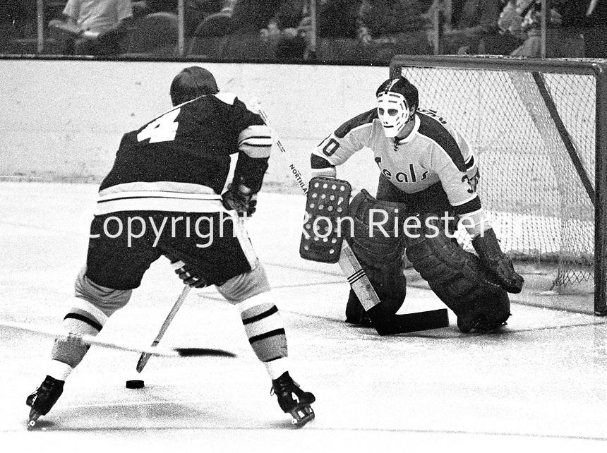 Boston Bruins Bobby Orr skates in on Seal goalie Chris Worthy..(1971 photo/Ron Riesterer)
