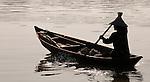 Hoi An Dawn 04 - Vietnamese boat woman in a small boat on the Thu Bon River, Hoi An, Viet Nam
