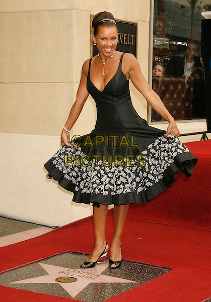 VANESSA L. WILLIAMS.Vanessa Williams Celebrates Her Birthday With a Star On The Hollywood Walk of Fame, Holllywood, California, USA..March 19th, 2007 .full length black dress floral print curtsy .CAP/ADM/RE.©Russ Elliot/AdMedia/Capital Pictures