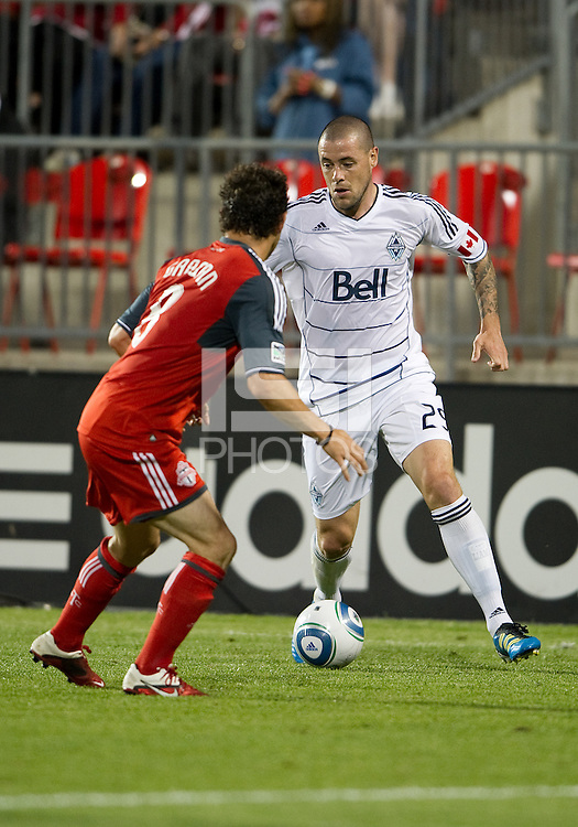 Vancouver Whitecaps FC forward Eric Hassli #29 and Toronto FC defender Dan Gargan #8 in action during an MLS game between the Vancouver Whitecaps FC and the Toronto FC at BMO Field in Toronto on June 29, 2011..Toronto FC won 1-0..